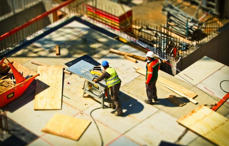 2-man-on-construction-site-during-daytime